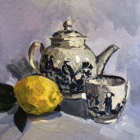 Blue and white teapot, coffee can and a lemon
