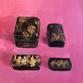 Four Japanese lacquer boxes on a pink ground