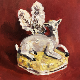 Seated Staffordshire deer on a red ground