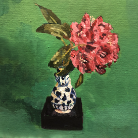 Rhododendron flower in a blue and white vase on a green ground