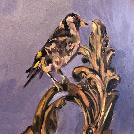 Stuffed Goldfinch on a sconce