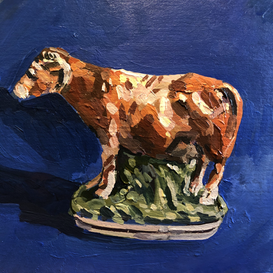 Staffordshire cow on a blue ground