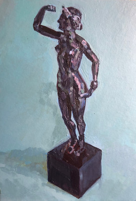Bronze female figure on a blue ground