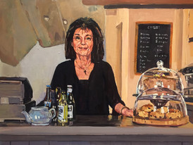 Maria at the counter of Bishop Percey's tearoom
