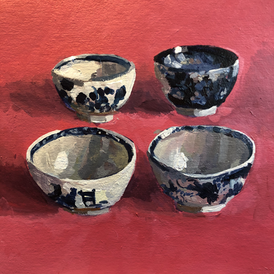 Four blue and white teabowls on a red ground