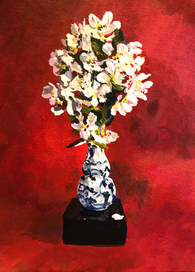 Apple blossom in a blue and white vase on a red ground