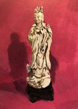 Blanc de Chine Buddha on a red ground