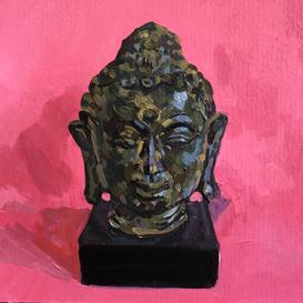 Bronze Buddha on a pink ground
