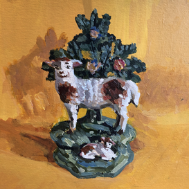 Staffordshire sheep and lamb on a yellow ground