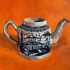 Early English blue and white teapot on an orange ground