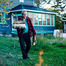 Charlie Angus in Cobalt carrying firewood