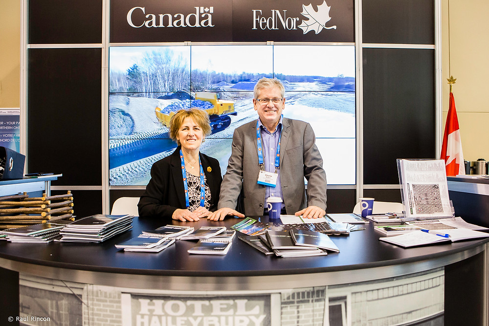 MP Carol Hughes and Charlie Angus standing in the FEDOR booth at the PDAC Conference