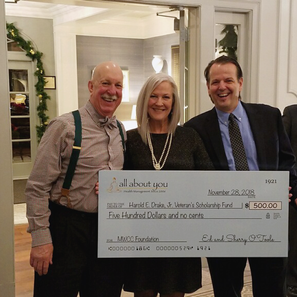 """Ed and Sherry are presenting to Jay Drake a $500 donation from """"all about you"""" for the Harold Drake veterans scholarship at Mount Wachusett Community College. The presentation was made at Oak Hill Country Club during the Jack Daniel's Dinner fundraising event for the scholarship."""
