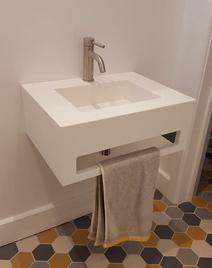 corian vanity unit with integrated sink and towel holder
