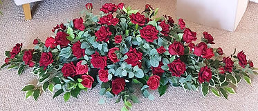 ARTIFICIAL FLOWERS COFFIN SPRAY RED ROSES AND ROSEBUDS.jpg