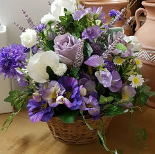 Silk Flowers Basket in Shades of Lilac .