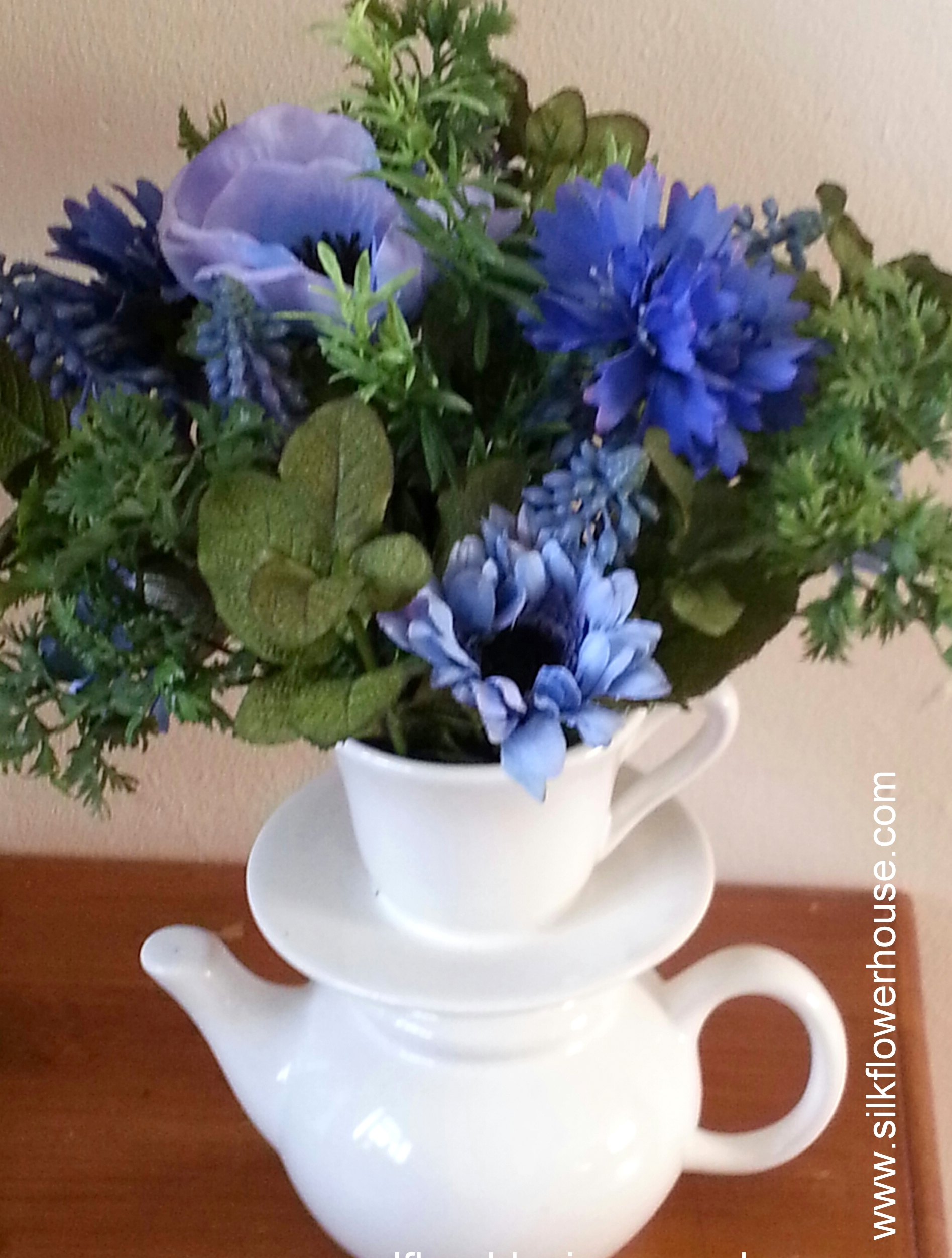 Teapot Vase with Silk Flowers and Herbs.