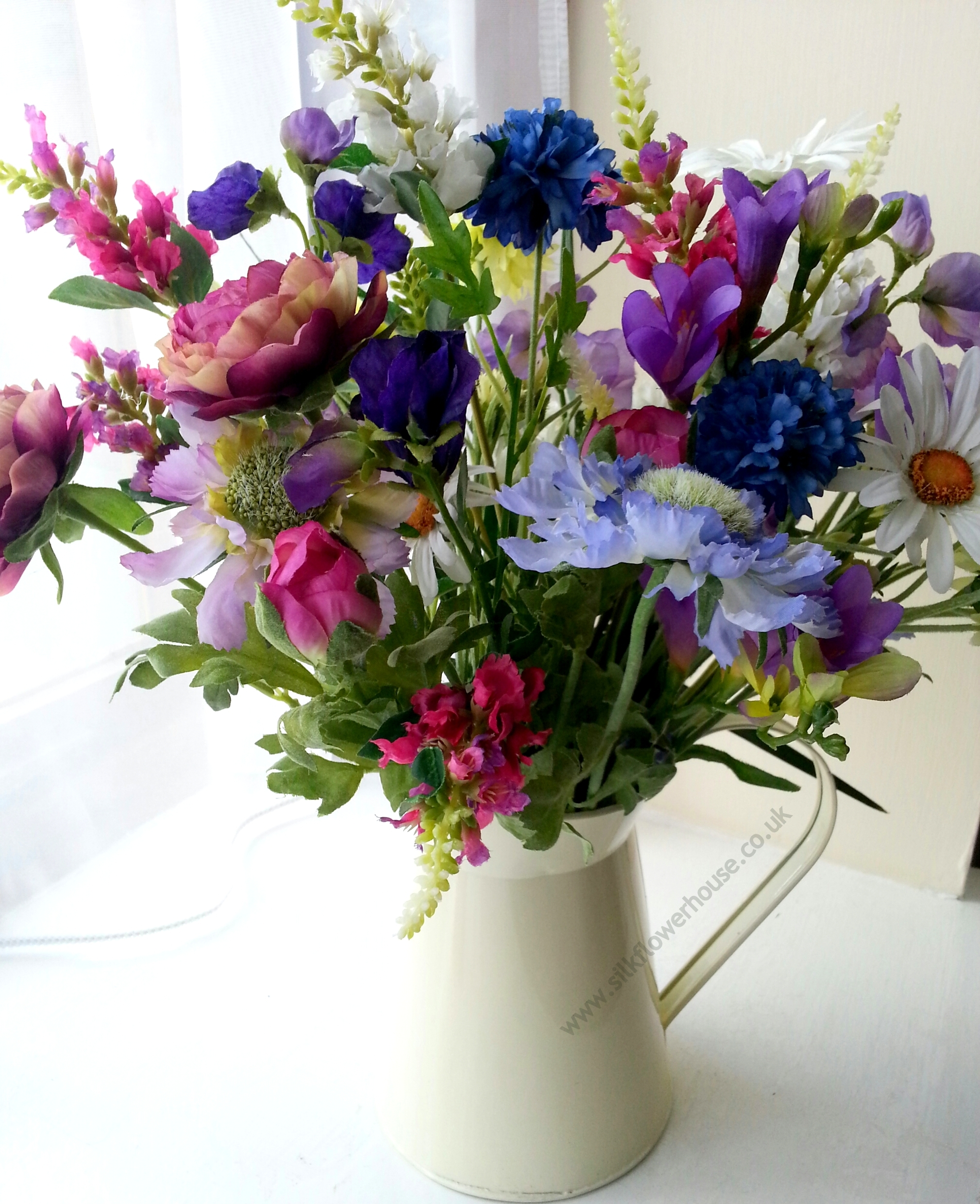 Jug of Mixed Silk Flowers