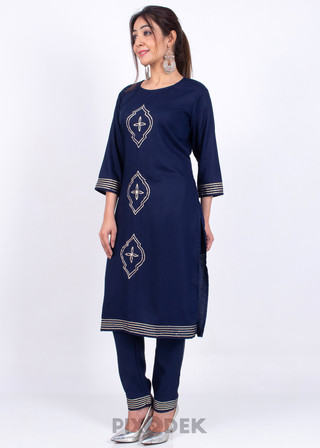 Catalog design for online sales. Model wearing kurti set and the background behind is white paper.