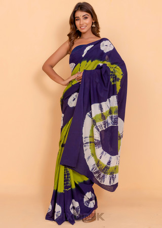 Catalog design for online sales. Model wearing cotton saree and the background behind is beige wall.