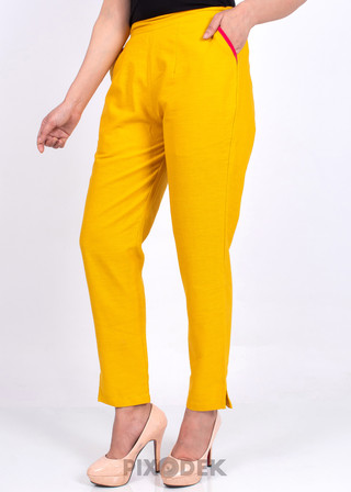Catalog design for online sales. Model wearing Cotton pants and the background behind is white paper. Side angle view.