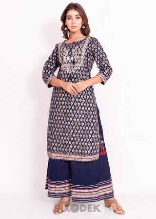 Catalog design for online sales. Model wearing designer kurti plazzo and the background behind is white paper.
