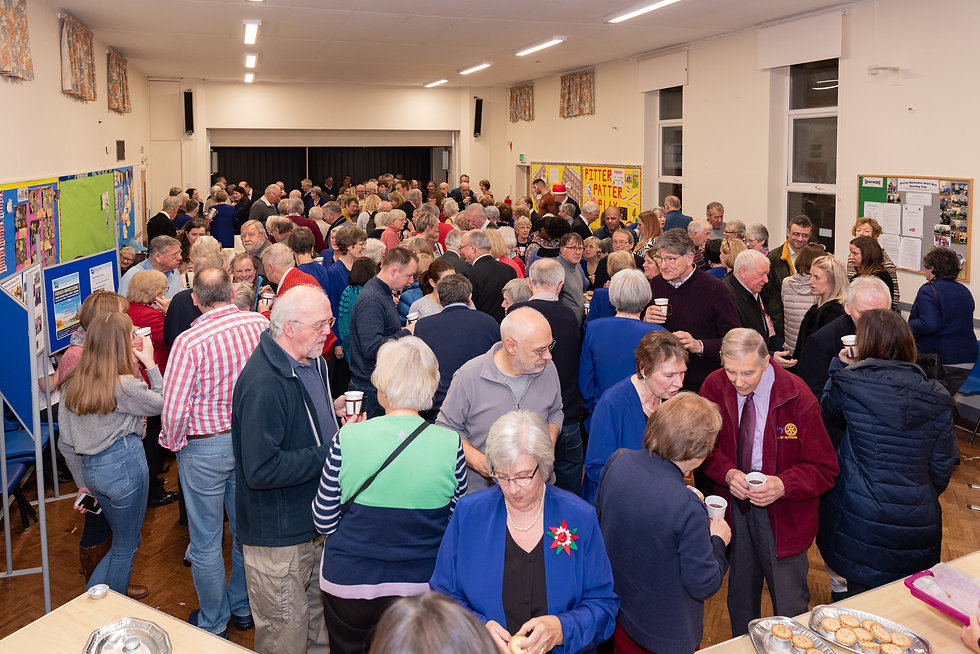 Audience enjoying tea, coffee and mince pies in the interval of the Christmas concert