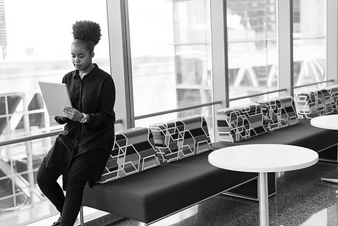 virtual working black women at big windo