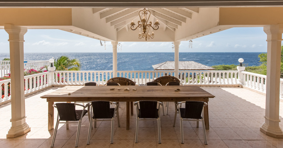 Sit back and savor the 180º ocean views from the large deck