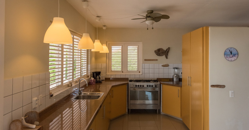 With a fully equiped gourmet kitchen