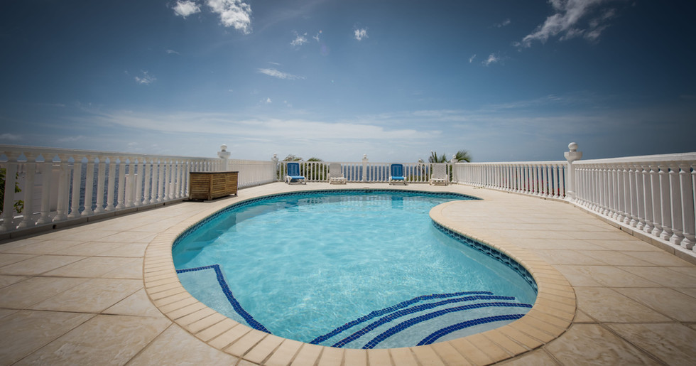 Or take a dip in the inviting pool overlooking the blue Caribbean Sea
