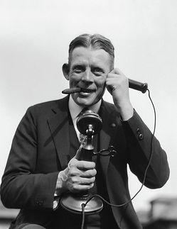 1920s-portrait-of-businessman-talking-vintage-images.jpg