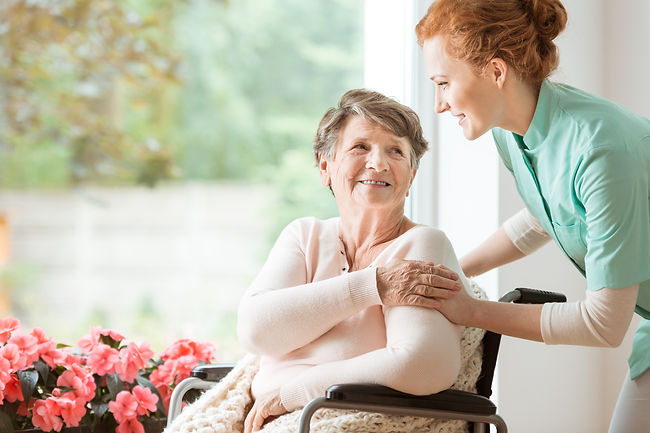 Young nurse helping an elderly woman in
