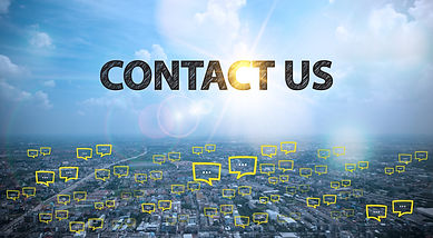CONTACT US  text on city and sky backgro