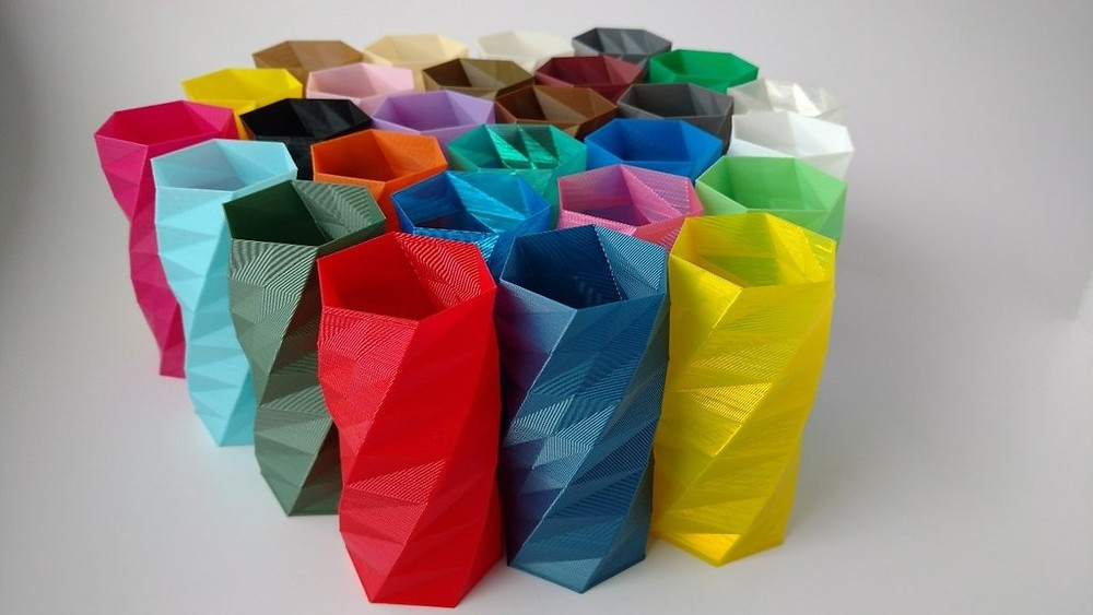 cilindros de material pla de colores