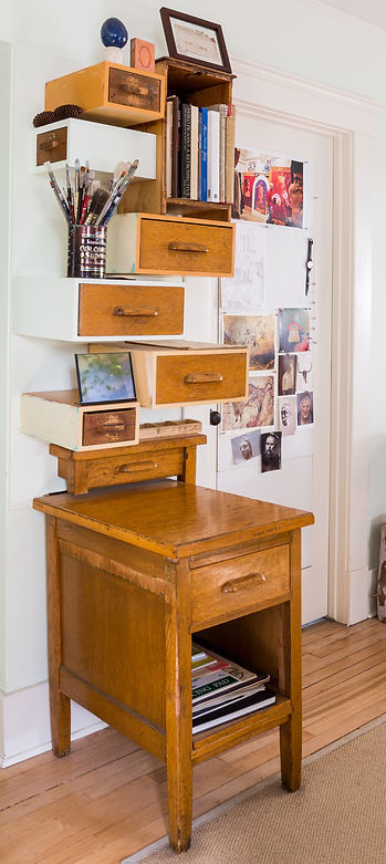 Transformed out an old oak Army desk, this has become a useful wall hanging of drawers and cupboards.