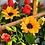 Thumbnail: Canasta de madera con botella de vino, mini girasoles y rosas.