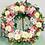 Thumbnail: Corona variedad de flores en tonos rosas y morados
