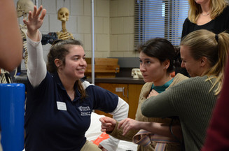 Brooke working as a simulated patient with Ithaca College Physical Therapy students.