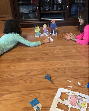 girls playing with paper dolls2.jpg