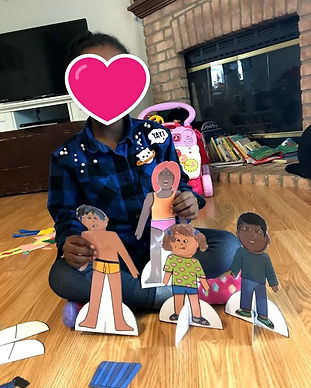 Selah playing with paper dolls2.jpg