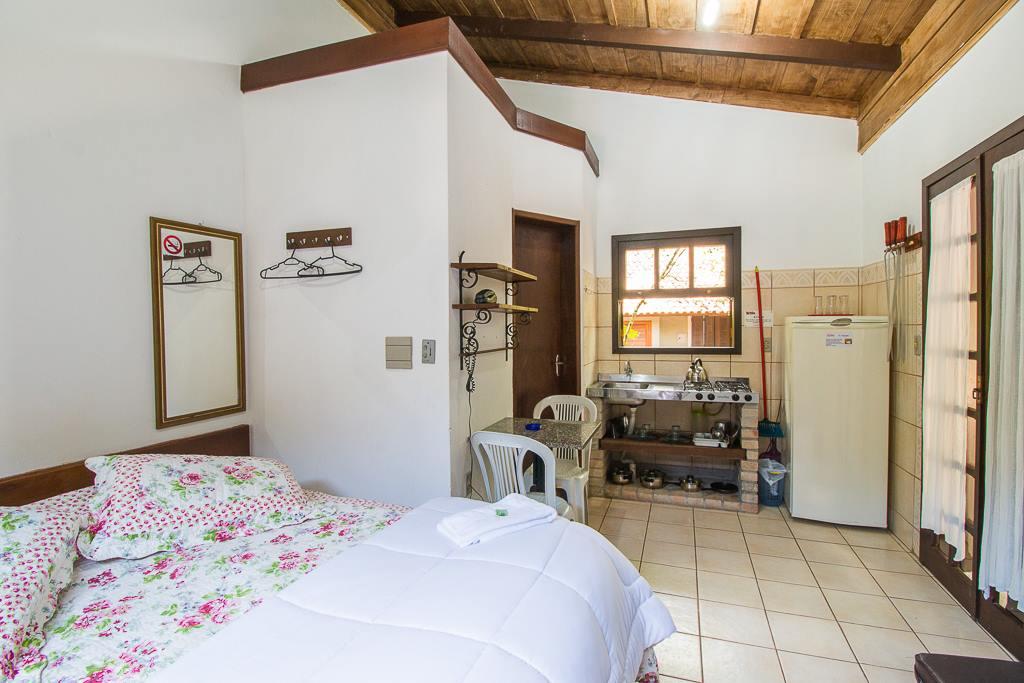 Dormitório e cozinha conjugados