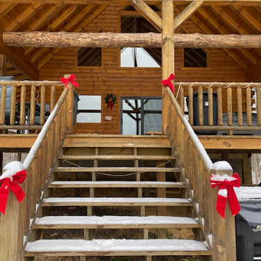 lodge entrance with christmas ribbons an