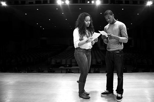 students-rehearsing-onstage-102754823-59