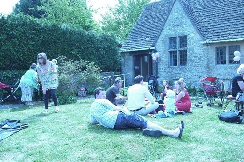 Christening party people on lawn