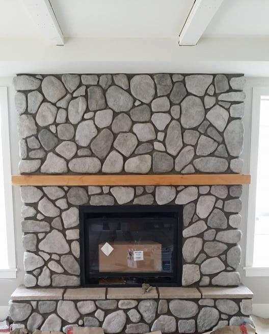 Lennox Masonry, Masonry Contractor, Stone Mason, Victoria BC, Vancouver Island - Cultured Granite River Rock Overtop of a Brick Fireplace