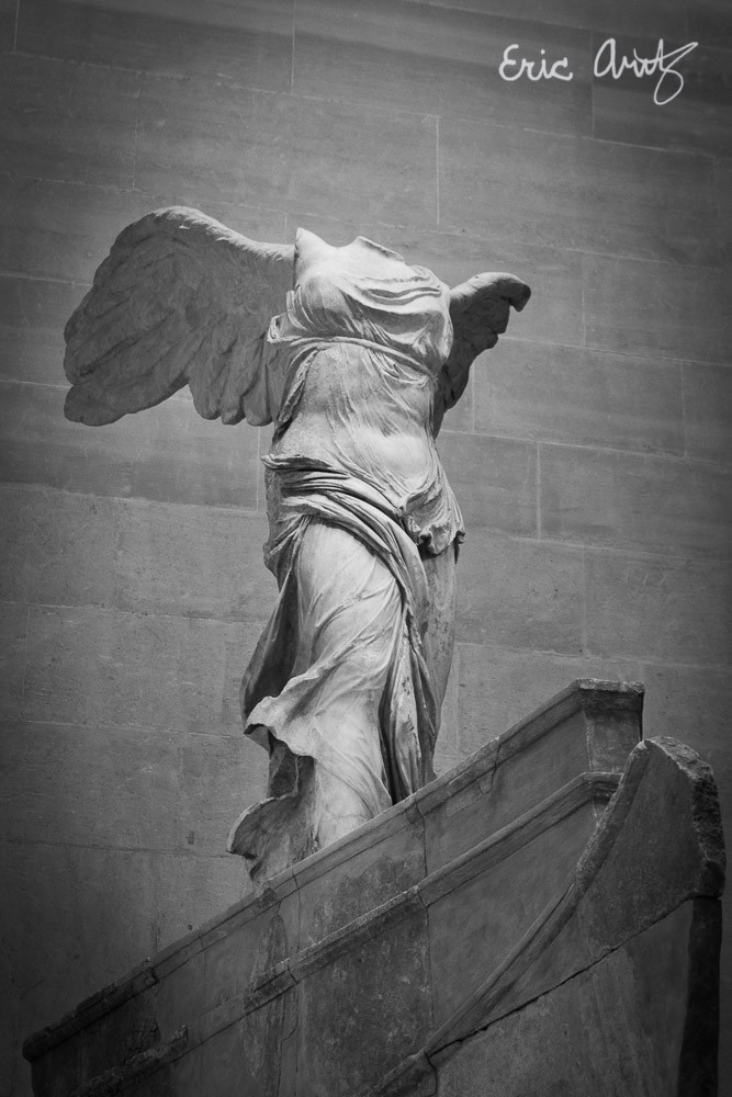 "Black and white photo of the ""Winged Victory of Samothrace"", The Louvre, Paris"