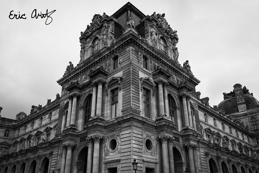 A black and white photo of the North Wing of the Louvre in Paris