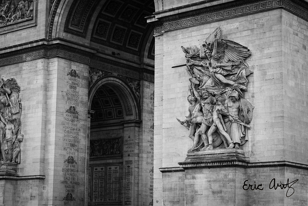 A black-and-white close-up of the detailing on the Arc de Triomphe in Paris.