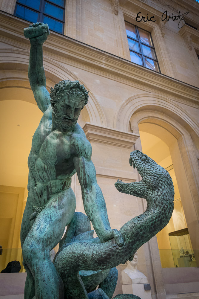 A man and serpent do battle at the Louvre in Paris